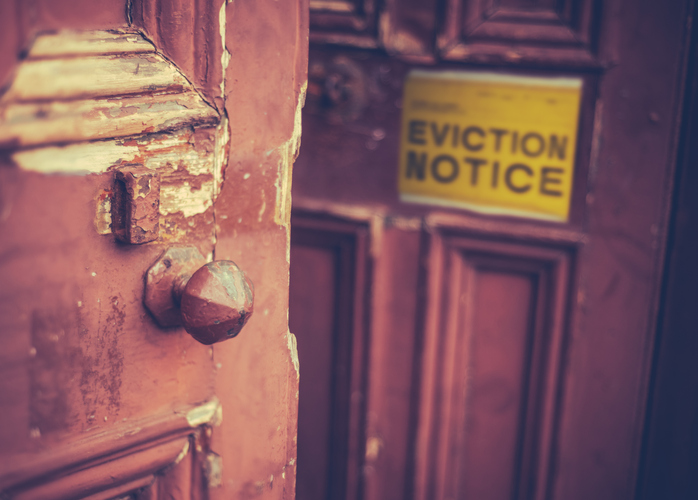 An eviction notice on a door to evict a tenant quickly.